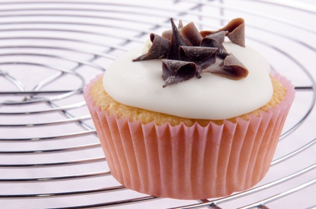 cupcake with white icing and chocolate curls photo