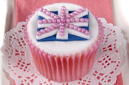 home baked cupcake with white icing and union jack photo