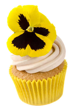 madeira cupcake with edible yellow pansy photo