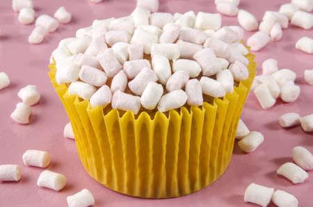 marshmellow: vanilla cupcake with white and pink marshmellow Stock Photo