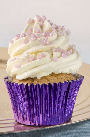 glimmer: cupcake with whipped double cream and pink glimmer crunch