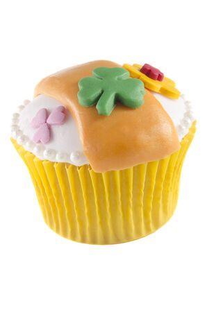 irish st patrick vanilla cupcake on a white background photo