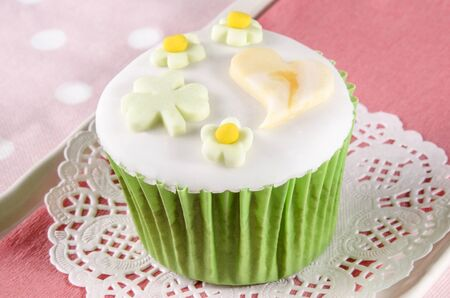 st patricks day cupcake with irish pastel color green, orange and white photo