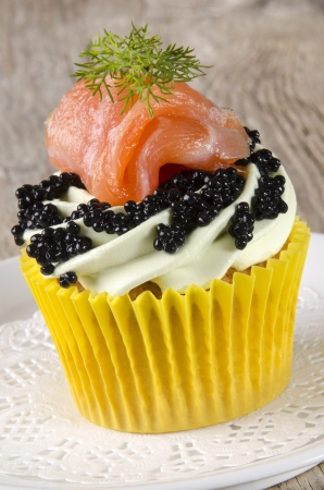 cupcake with mint butter cream, smoked salmon and caviar Stock Photo - 17541112
