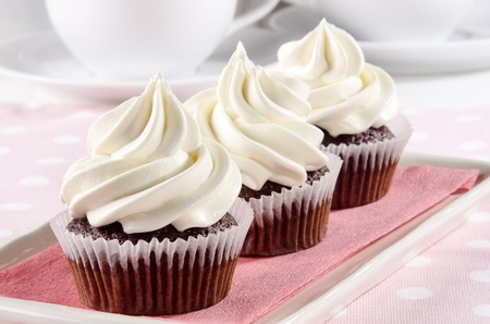 patty cake: home made chocolate cupcake with butter cream Stock Photo
