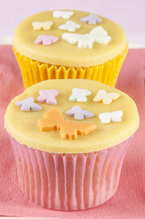 cupcake with golden marzipan and butterflies photo