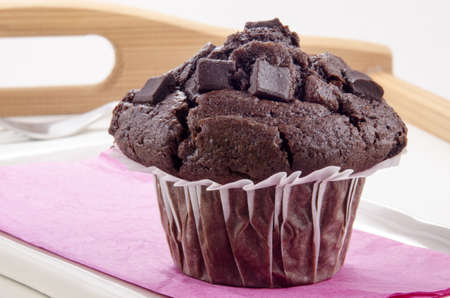 home made chocolate muffin on a breakfast tray photo