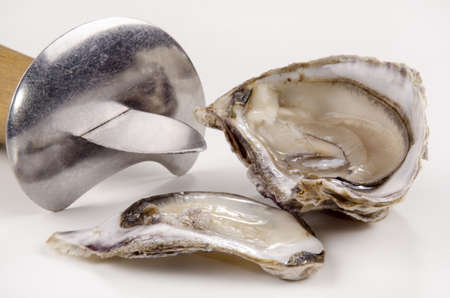 open oyster and oyster knife on bright background photo