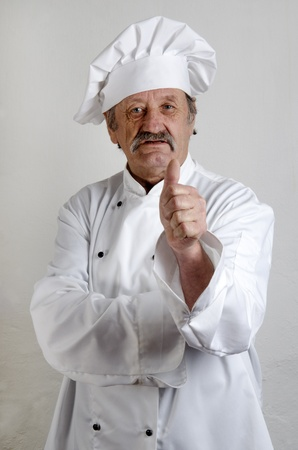 professional chef in white working uniform photo