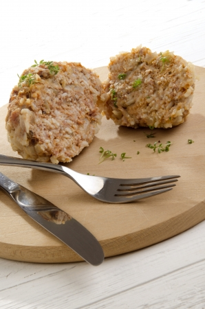 water cress: cooked meatball with long grain rice on a wooden plate Stock Photo