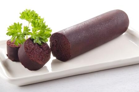 home made irish black pudding with parsley Stock Photo