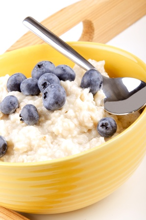 porridge with blueberries in a yellow bowl photo