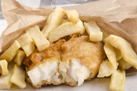 fish and french fries in a brown bag photo