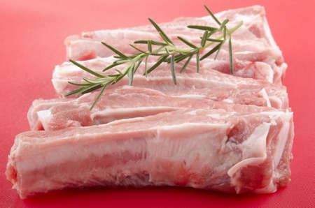 coded: raw pork ribs on a color coded cutting board Stock Photo