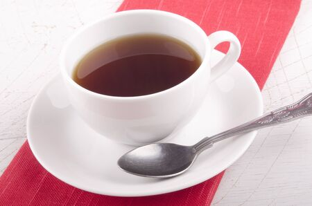 english breakfast tea: english breakfast tea in a white cup and a spoon Stock Photo