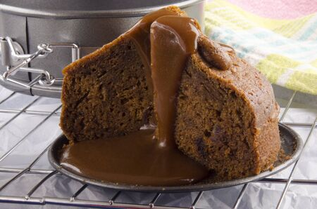 toffee pudding with caramel sauce on a cooling rack photo