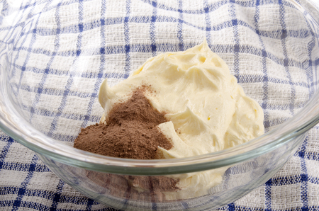 airy: airy butter and cocoa in a glass bowl Stock Photo