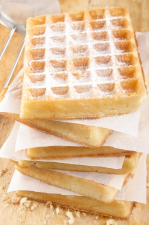 powdered sugar: home baked waffle with powdered sugar on a preparation rack