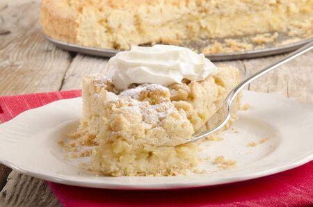 crumb cake with powdered sugar and cream
