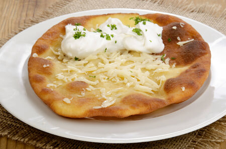 Langos, home made Hungarian pancake with sour cream and cheese