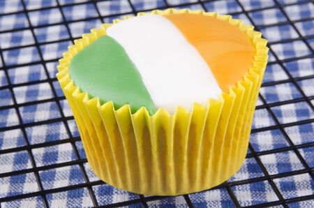vanilla cupcake with irish colours, green, white and orange photo