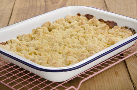 apple crumble: freshly baked apple crumble in an enamel bowl