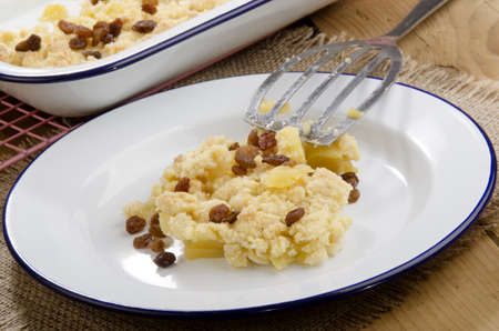 apple crumble:  baked apple crumble with raisins on a plate Stock Photo