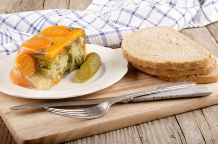 vegetarian vegetable aspic and bread on a wooden board photo