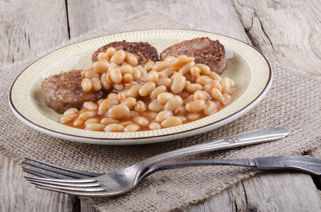 traditionally irish: baked beans and fried white pudding on a plate Stock Photo