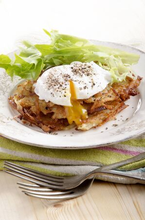 potato pancake with poached egg and salad photo