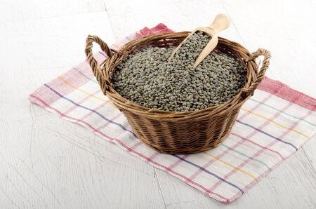 green lentil: green lentil and wooden shovel in a basket