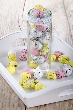 serving tray:  chocolate easter eggs in a glass and on serving tray Stock Photo
