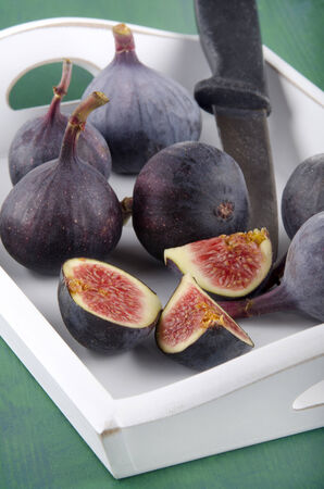 serving tray: sweet fig and knife on a white serving tray