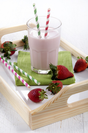 serving tray: cold strawberry milkshake on a serving tray