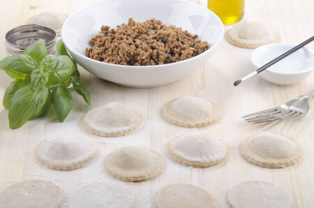ravioli, basil, oil, water, brush and mince meat photo
