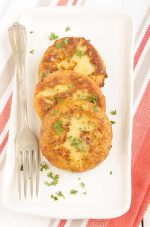 potato cake with parsley and fork on a plate photo