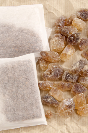 brown rock candy sugar and tea bags photo
