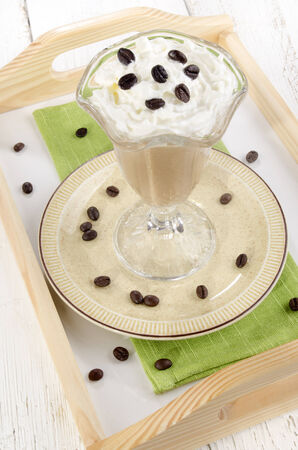 serving tray: cold ice coffee in a glass on a serving tray Stock Photo