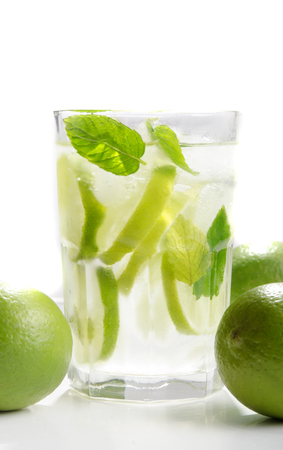 longdrink: longdrink mojito rum cocktail with ice, rum, lime, and mint leaves