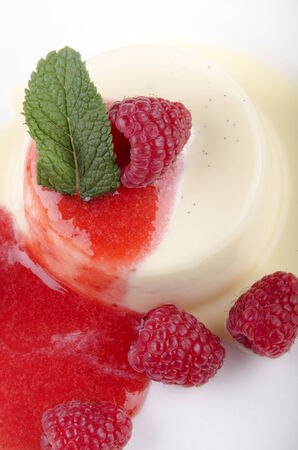 panna cotta with raspberry, mint and fruit sauce photo