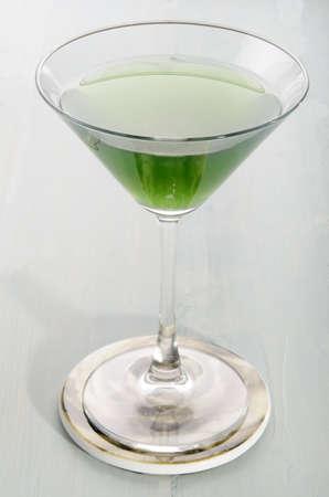 woodruff: green woodruff vodka cocktail in a glass