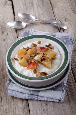 sliver: rice pudding with nectarines and roasted almond sliver in a bowl