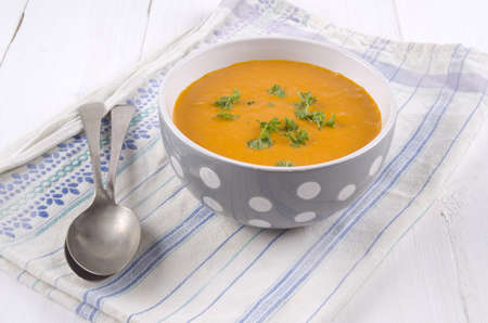 pumpkin cream soup with parsley in a bowl Stock Photo
