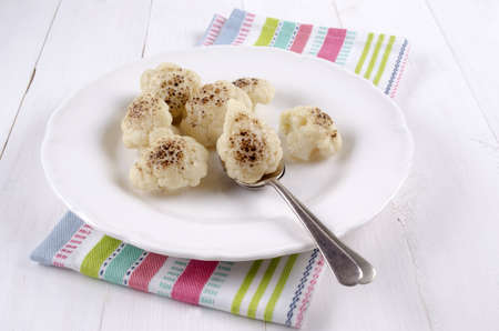 florets: oven baked cauliflower florets on a white plate
