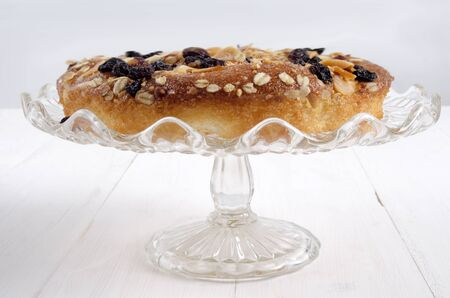 cake stand: fresh baked muesli tart on a glass cake stand
