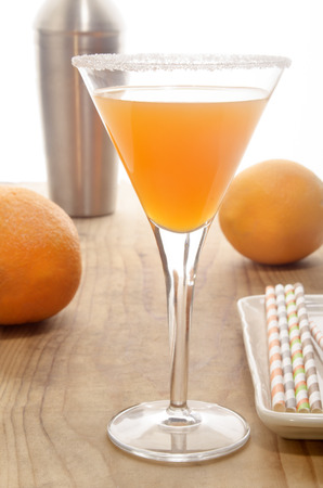 sugared: orange vodka in a cocktail glass with sugared rim