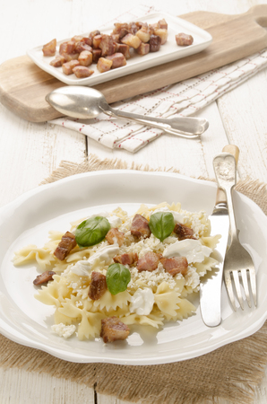 pancetta cubetti: farfalle pasta with cottage cheese sour cream and basil