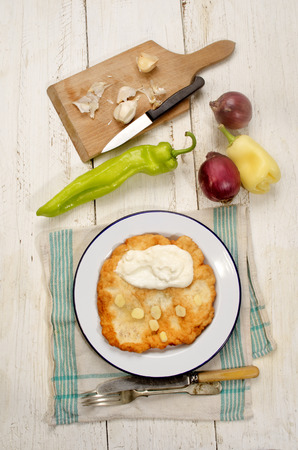 sour cream: hungarian breakfast with langos, sour cream, garlic, onion and paprika