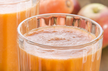 organic carrot and apple smoothie in a glass