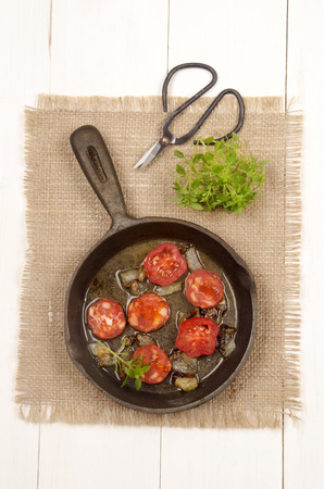 cast iron pan: spanish chorizo with tomato, sweet basil and onion in a cast iron pan